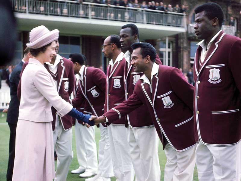 queen shaking cricket players hands