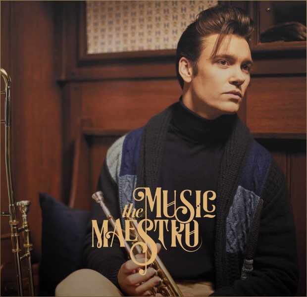 The music maestro is one of the 12 gentlemen of christmas wearing Hackett London clothing