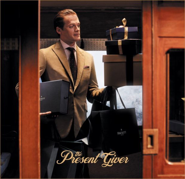 The present giver is one of the 12 gentlemen of christmas wearing Hackett London clothing