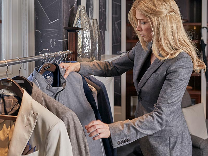 Madeleine Letchford picking out jacket from a Hackett jacket rail