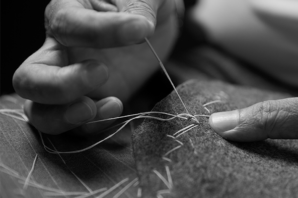 Close up of man sewing