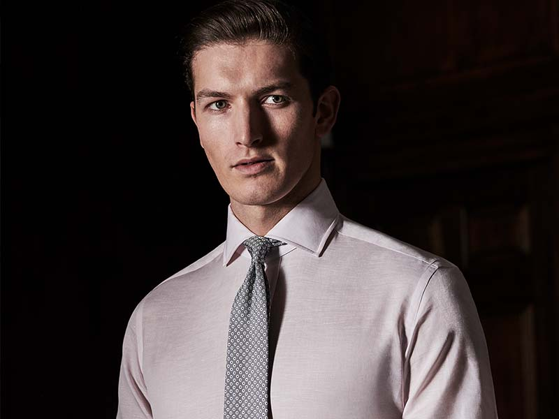 man in crisp shirt with tie on