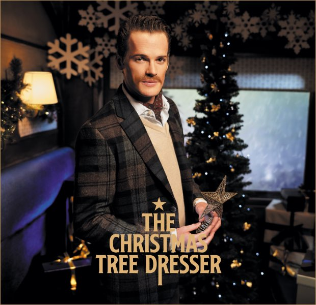 The christmas tree dresser is one of the 12 gentlemen of christmas wearing Hackett London clothing