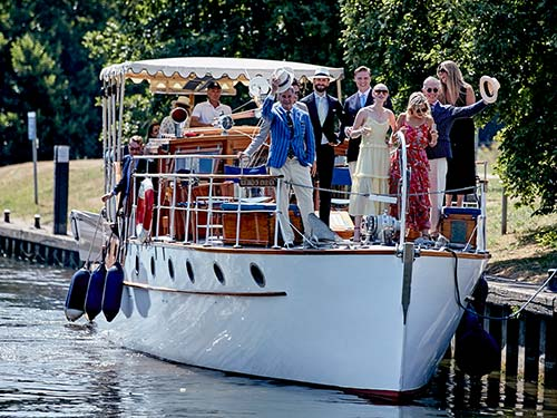 Group of people celebrating on boat