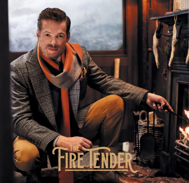 The fire tender is one of the 12 gentlemen of christmas wearing Hackett London clothing