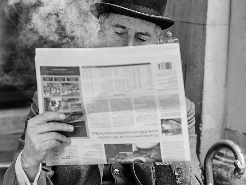 Jeremy Hackett reading newspaper